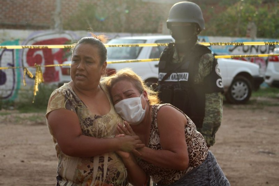 Women react outside a drug rehabilitation facility where assailants killed several people, according to Guanajuato state police, in Irapuato, Mexico July 1, 2020. REUTERS/Karla Ramos