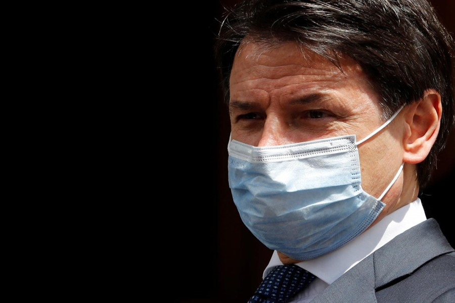 FILE PHOTO: Italian Prime Minister Giuseppe Conte wearing a protective face mask, leaves the Senate as the spread of the coronavirus disease (COVID-19) continues, in Rome, Italy May 20, 2020. REUTERS/Remo Casilli