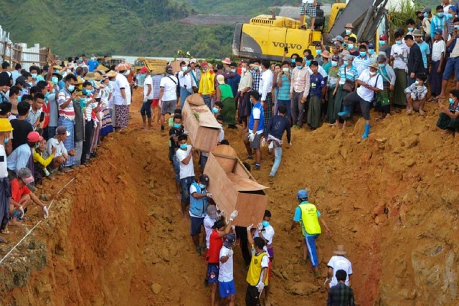 Dozens more jade miners killed in a landslide in northern Myanmar will be buried on Saturday, a local official said, after 77 others were interred in a mass grave on Friday following one of the worst mining accidents in the country's history, reports Reuters.  More than 170 people, many of them migrants seeking their fortune in the jade-rich Hpakant area of Kachin state, died on Thursday after mining waste collapsed into a lake, triggering a surge of mud and water. The miners were collecting stones in Hpakant - the centre of Myanmar's secretive billion-dollar jade industry - when the wave crashed onto them, entombing them under a layer of mud. Thar Lin Maung, a local official from the information ministry, told Reuters by phone on Saturday 171 bodies had been pulled out but more were continuing to float to the surface. He said the 77 buried on Friday had been identified and 39 would be interred on Saturday. Volunteers carried plywood coffins and placed them into a mass grave carved out by diggers close to the mine site. Many other bodies, battered and stripped of their clothing by the force of the wave that hit them, still have not been identified. Myanmar supplies 90 per cent of the world's jade, the vast majority of which is exported to neighbouring China, which borders Kachin state. Deadly landslides and other accidents are common in the mines, which draw impoverished workers from across Myanmar. About 100 people were killed in a 2015 collapse that led to calls to regulate the industry. Another 50 died in 2019. But Thursday's landslide was the worst in memory. The country's leader, Aung San Suu Kyi, on Friday blamed the disaster on joblessness in the country, lamenting in a Facebook Live broadcast that informal workers had to go to the mines for lack of other employment. The government announced the formation of a committee to investigate the disaster. However, activists say little has changed in the industry despite a pledge from Suu Kyi's government to clean it