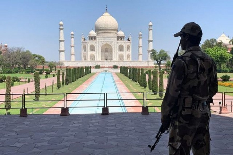 A member of Central Industrial Security Force (CISF) personnel stands guard inside the empty premises of the historic Taj Mahal during a 21-day nationwide lockdown to slow the spread of Covid-19, in Agra, India, April 02, 2020 — Reuters/Files