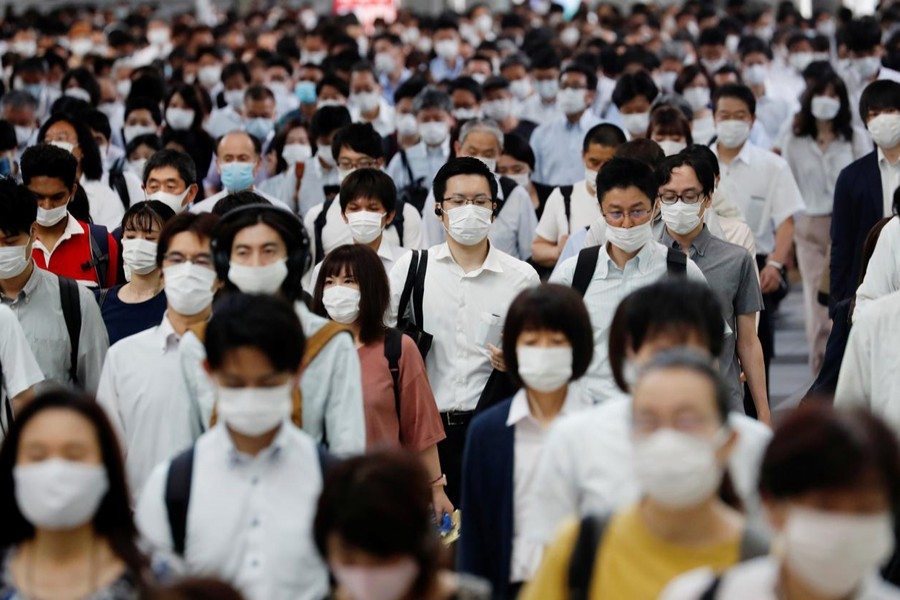 People wearing protective masks amid the coronavirus disease (COVID-19) outbreak, make their way during rush hour at a railway station in Tokyo, Japan on July 3, 2020 — Reuters/Files