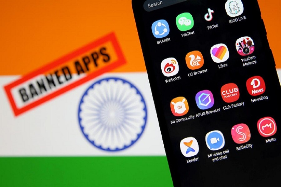"""A smartphone with Chinese applications is seen in front of a displayed Indian flag and a """"Banned app"""" sign in this illustration picture taken July 02, 2020 — Reuters/Files"""
