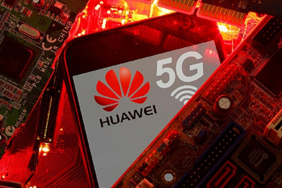 A smartphone with the Huawei and 5G network logo is seen on a PC motherboard in this illustration picture taken January 29, 2020 — Reuters/Files