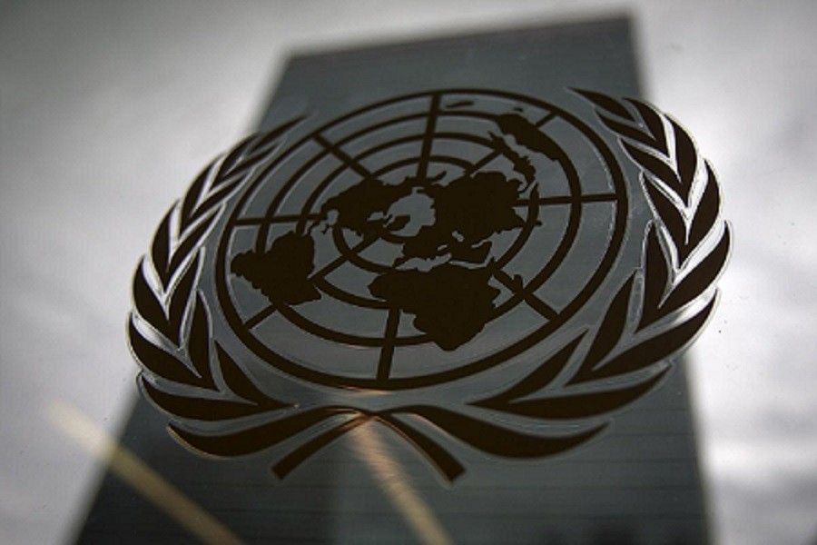 The United Nations headquarters building is pictured though a window with the UN logo in the foreground in the Manhattan borough of New York August 15, 2014 — Reuters/Files