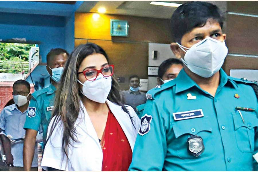 JKG Health Care's Dr Sabrina Arif Chowdhury being taken away by police after interrogation at the Tejgaon DC office in Dhaka city on Sunday — Focus Bangla