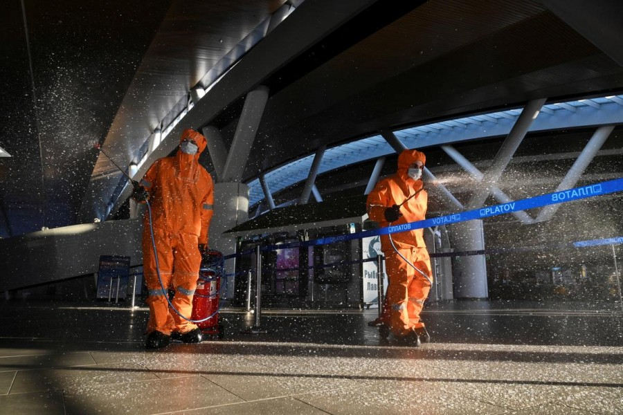 Specialists wearing protective gear spray disinfectant while sanitising Platov International Airport amid the coronavirus disease (Covid-19) outbreak near Rostov-on-Don, Russia on April 15, 2020 — Reuters/Files