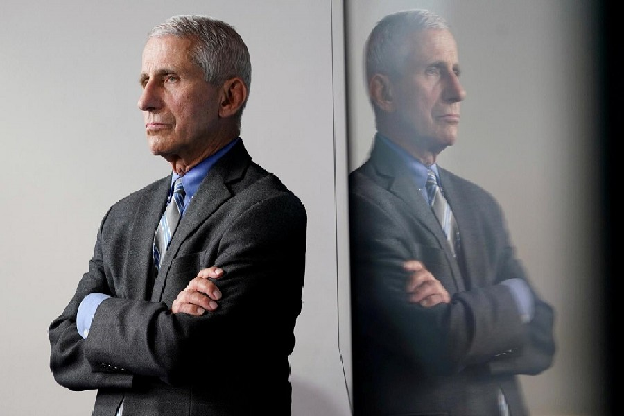 National Institute of Allergy and Infectious Diseases Director Dr Anthony Fauci is reflected in a video monitor behind him on stage as he listens to the daily coronavirus task force briefing at the White House in Washington, US, April 08, 2020 — Reuters/Files