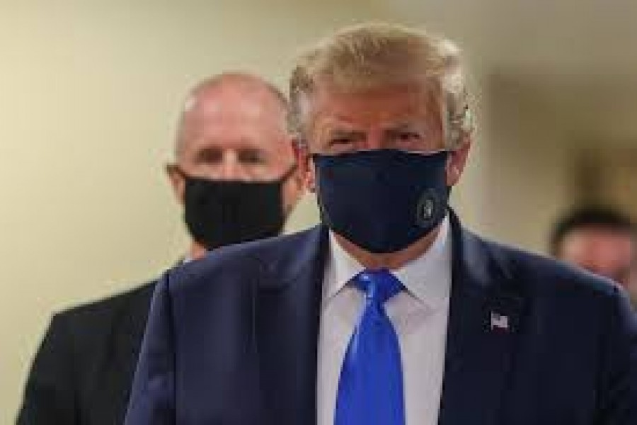 President Donald Trump, who has avoided wearing a mask in public even as the coronavirus pandemic spread, donned one on July 11 at a military medical facility outside Washington where he was to meet with wounded soldiers and front-line health-care workers.  -- Reuters photo
