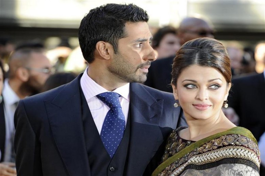 Bollywood couple Abhishek Bachchan (L) and Aishwarya Rai Bachchan arrive for the world premiere of their film 'Raavan' at the BFI in London, June 16, 2010. REUTERS/Paul Hackett