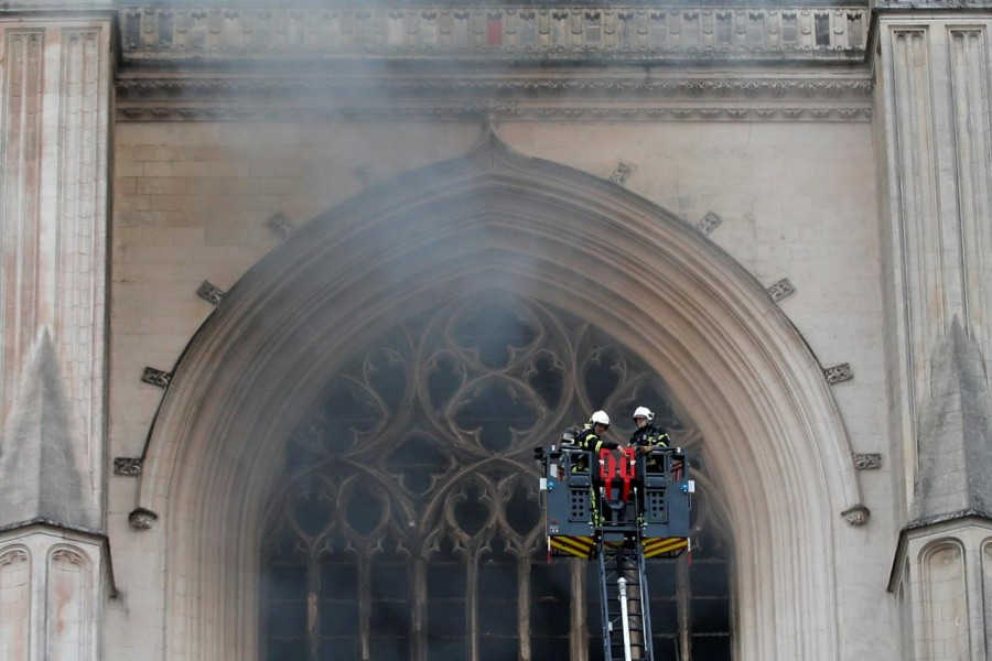 French firefighters battle a blaze at the Cathedral of Saint Pierre and Saint Paul in Nantes, France, July 18, 2020. REUTERS/Stephane Mahe