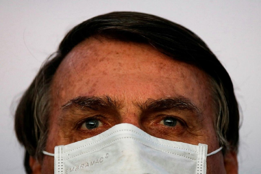 Brazil's President Jair Bolsonaro looks on during a ceremony of lowering the national flag for the night, amid the coronavirus disease (Covid-19) outbreak, at the Alvorada Palace in Brasilia, Brazil, July 18, 2020 — Reuters