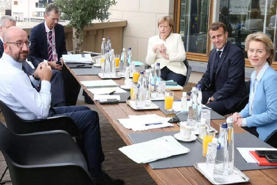 President of the European Council Charles Michel (L), Germany's Chancellor Angela Merkel (C), France's President Emmanuel Macron (2nd R) and President of the European Commission Ursula von der Leyen pose during a meeting at the first face-to-face EU summit since the coronavirus disease (Covid-19) outbreak, in Brussels, Belgium, July 19, 2020 — Francois Walschaerts/Pool via Reuters