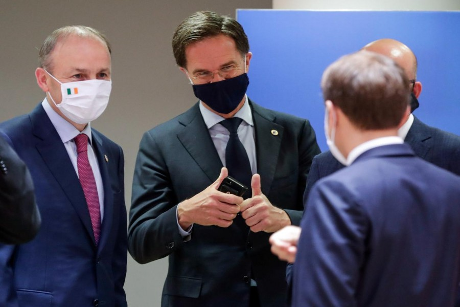 Ireland's Taoiseach Micheal Martin, Netherlands' Prime Minister Mark Rutte and France's President Emmanuel Macron interact at the last roundtable discussion following a four-day European summit at the European Council in Brussels, Belgium, July 21, 2020. Stephanie Lecocq/Pool via REUTERS