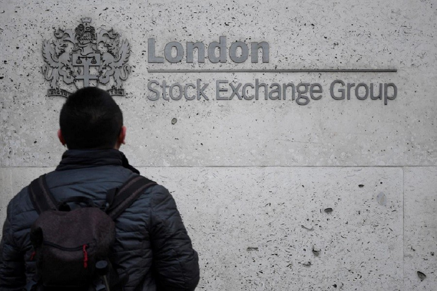 People walk past the London Stock Exchange Group offices in the City of London, Britain, December 29, 2017 — Reuters/Files