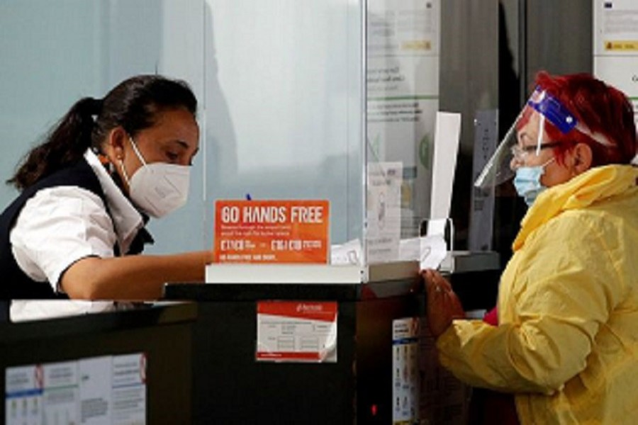 A woman stands at the EasyJet check-in desk at Josep Tarradellas Barcelona-El Prat airport, amid the spread of the coronavirus disease (Covid-19), in Barcelona, Spain, July 26, 2020 — Reuters