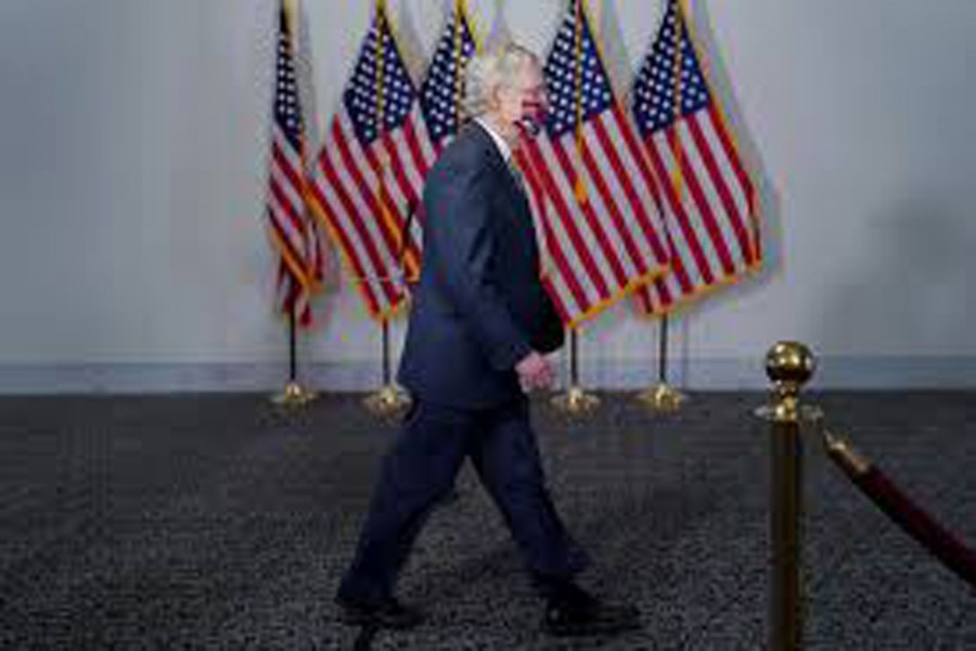 FILE PHOTO: Senate Majority Leader Mitch McConnell arrives to a luncheon on Capitol Hill in Washington, U.S. July 23, 2020. REUTERS/Erin Scott