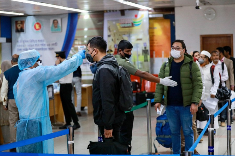Passengers are checked with thermal scanner at the Hazrat Shahjalal International Airport as a preventive measure against coronavirus in Dhaka on 11 March, 2020 — Reuters/Files