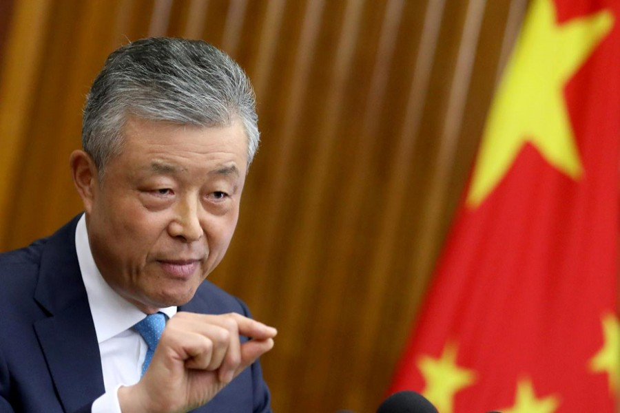 FILE PHOTO: Chinese Ambassador to Britain Liu Xiaoming gestures during a news conference in London, Britain, Aug. 15 2019. REUTERS/Simon Dawson/File Photo