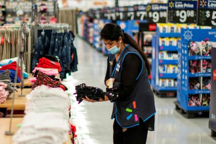 A worker is seen wearing a mask while organising merchandise at a Walmart store, in North Brunswick, New Jersey, US, July 20, 2020 — Reuters