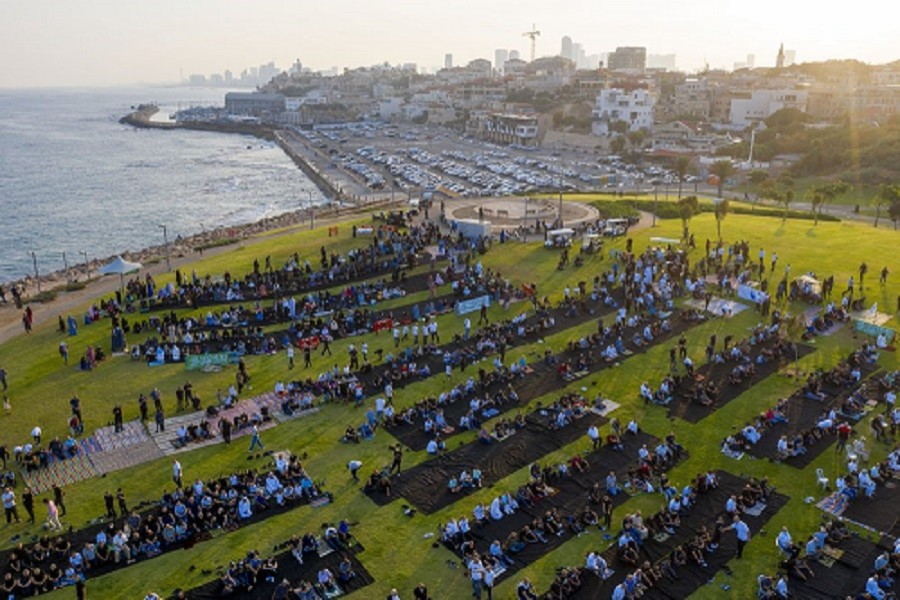 Muslim worshippers offer Eid al-Adha prayer at a park as mosques are limited for ten people following the government's measures to help stop the spread of the coronavirus, in the mixed Arab Jewish city of Jaffa, near Tel Aviv, Israel, Friday, July 31, 2020 — AP