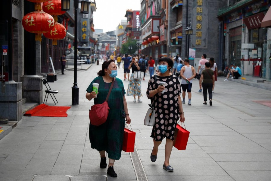 People wear protective masks as they walk in a shopping street following the outbreak of the coronavirus disease (Covid-19) in a historic part of Beijing, China on July 30, 2020 — Reuters photo