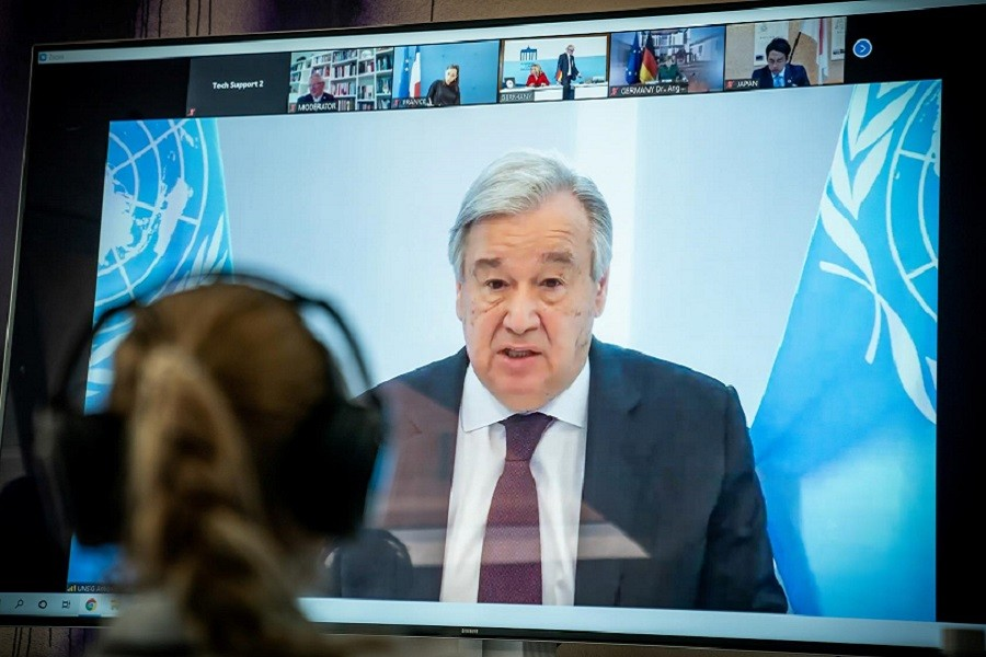 United Nations Secretary-General Antonio Guterres is seen on a video screen during a virtual climate summit, known as the Petersberg Climate Dialogue, in Berlin on April 28, 2020 — Reuters