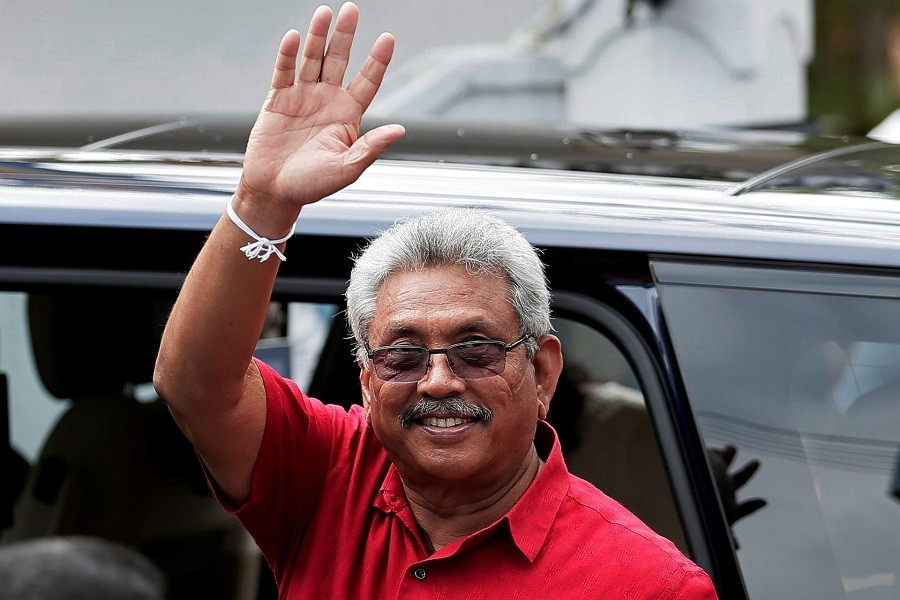 Sri Lanka's President Gotabaya Rajapaksa waves at his supporters as he leaves a polling station after casting his vote during the country's parliamentary election in Colombo, Sri Lanka, August 05, 2020 — Reuters