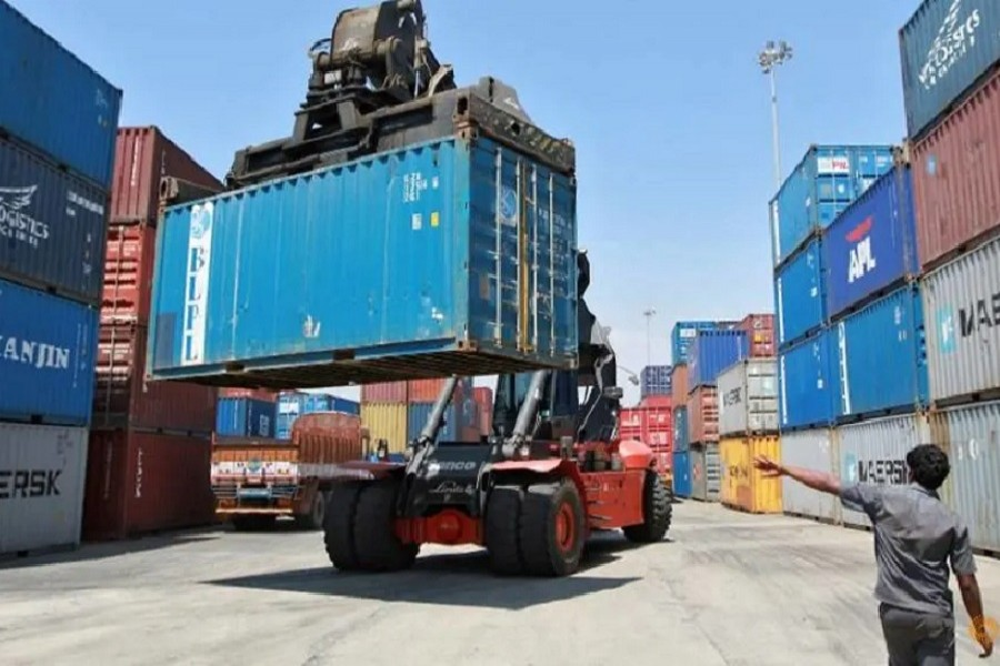 A mobile crane prepares to stack a container at a port in the southern Indian city of Chennai, March 16, 2012 — Reuters/Files
