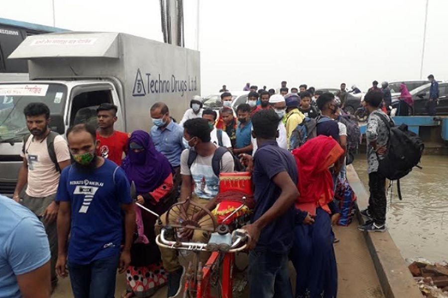 Eid holidaymakers crowded the Paturia-Daulatdia ferry to cross the Padma river. The photograph was taken from the Daulatdia ferry ghat on Sunday — FE Photo