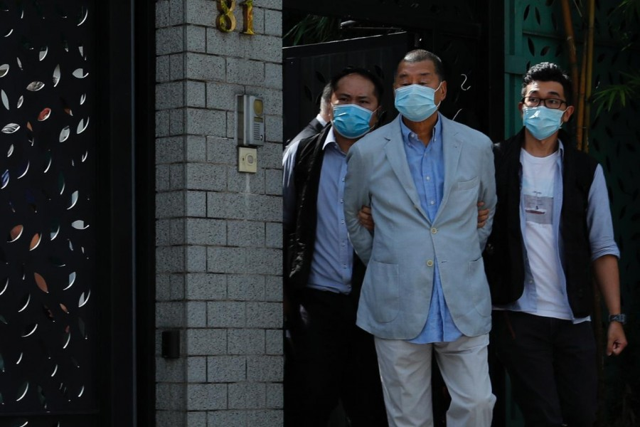 Media mogul Jimmy Lai Chee-ying, founder of Apple Daily (C) is detained by the national security unit in Hong Kong, China August 10, 2020. REUTERS/Tyrone Siu