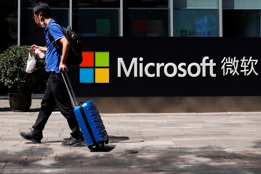 A person walks past a Microsoft logo at the Microsoft office in Beijing, China, August 04, 2020 — Reuters