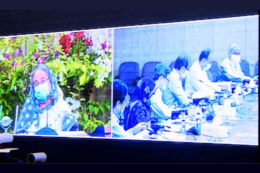 Prime Minister Sheikh Hasina presiding over weekly cabinet meeting through a videoconference from Ganabhaban on Monday, while other cabinet members got connected from the secretariat  -PID Photo