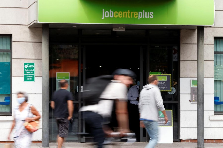 People walk past a branch of Jobcentre Plus, a government run employment support and benefits agency, as the outbreak of the coronavirus disease (Covid-19) continues, in Hackney, London, Britain on August 6, 2020 — Reuters photo