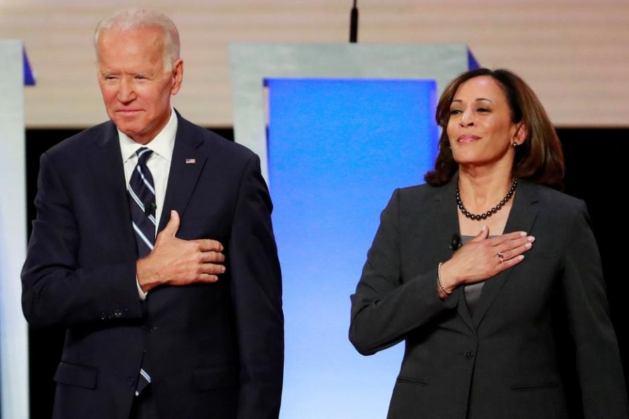 Former US Vice President Joe Biden and Senator Kamala Harris take the stage before the start of the second night of the second US 2020 presidential Democratic candidates debate in Detroit, Michigan, US on July 31, 2019 — Reuters/Files
