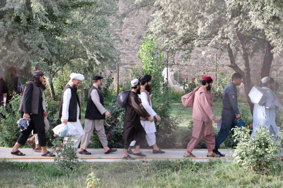 Newly freed Taliban prisoners walk at Pul-e-Charkhi prison, in Kabul, Afghanistan on August 13, 2020. National Security Council of Afghanistan/Handout via REUTERS