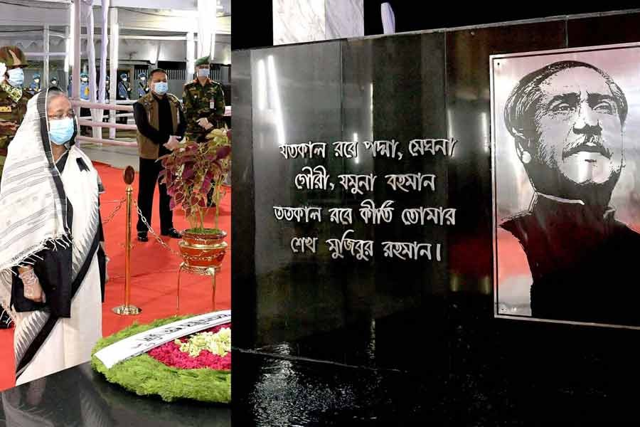 Prime Minister Sheikh Hasina standing in solemn silence after placing a wreath at the portrait of Father of the Nation Bangabandhu Sheikh Mujibur Rahman at the Bangabandhu Memorial Museum at Dhanmondi Road No. 32 in the capital on Staruday marking the National Mourning Day –PID Photo