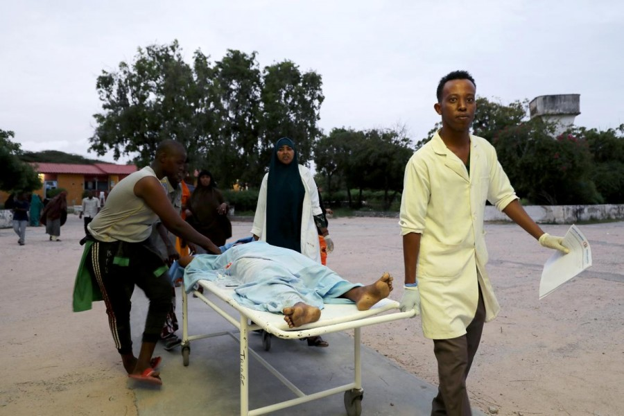 Civilians assist an injured person at Madina hospital after a blast at the Elite Hotel in Lido beach in Mogadishu, Somalia on August 16, 2020 — Reuters photo