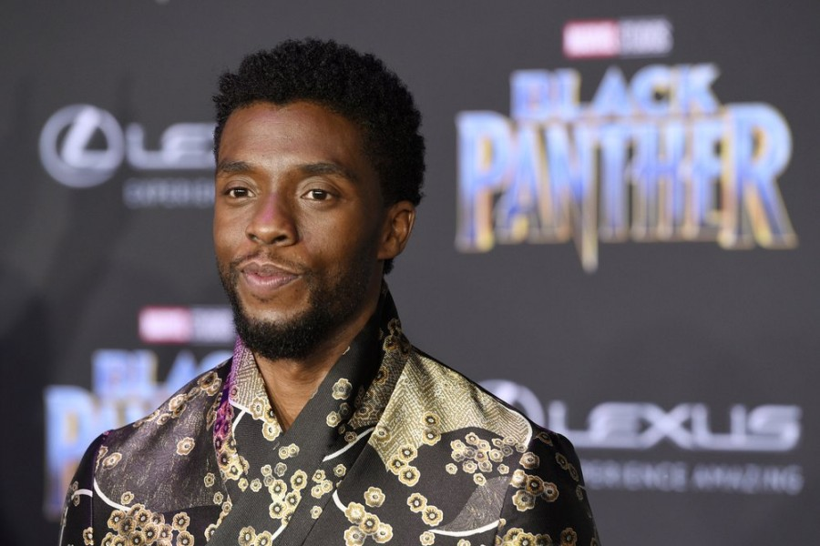 """In this Jan. 29, 2018 file photo, Chadwick Boseman, a cast member in """"Black Panther,"""" poses at the premiere of the film in Los Angeles - Photo by Chris Pizzello/Invision/AP, File"""