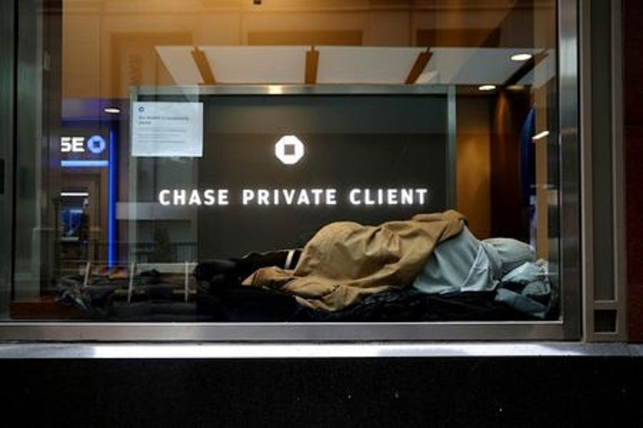 A homeless man sleeps in a closed Chase bank branch on a nearly deserted Wall Street in the financial district in lower Manhattan during the outbreak of the coronavirus disease (Covid-19) in New York City, New York, US, April 3, 2020 — Reuters/Files