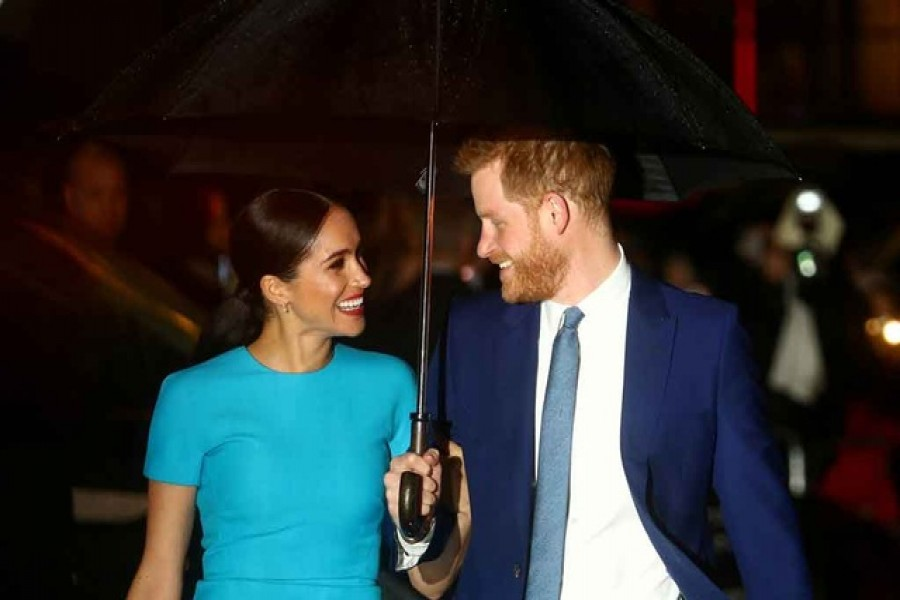 FILE PHOTO: Britain's Prince Harry and his wife Meghan, Duchess of Sussex, arrive at the Endeavour Fund Awards in London, Britain March 5, 2020. REUTERS