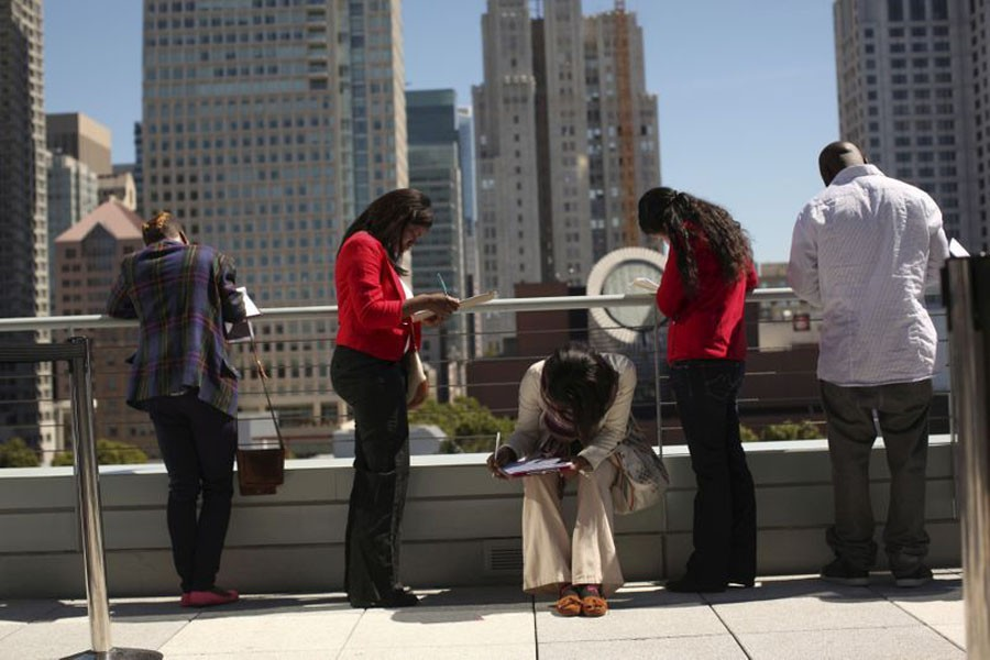 FILE PHOTO: Job seekers apply for the 300 available positions at a new Target retail store in San Francisco, California August 09, 2012. REUTERS/Robert Galbraith/File Photo/File Photo