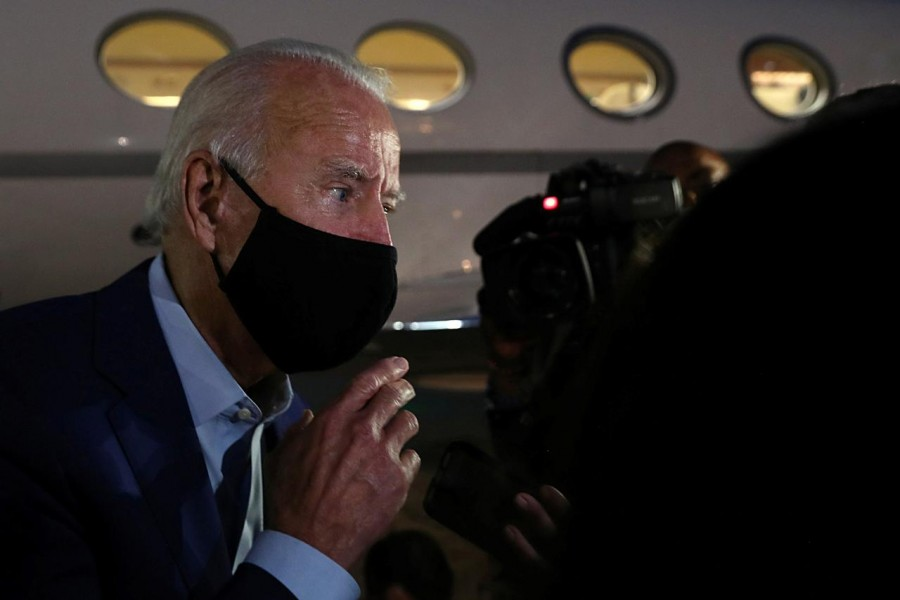 Democratic US presidential nominee and former Vice President Joe Biden speaks to the media at the end of his visit, before leaving for Delaware, at Detroit Metropolitan Wayne County Airport in Detroit, Michigan on September 9, 2020 — Reuters photo