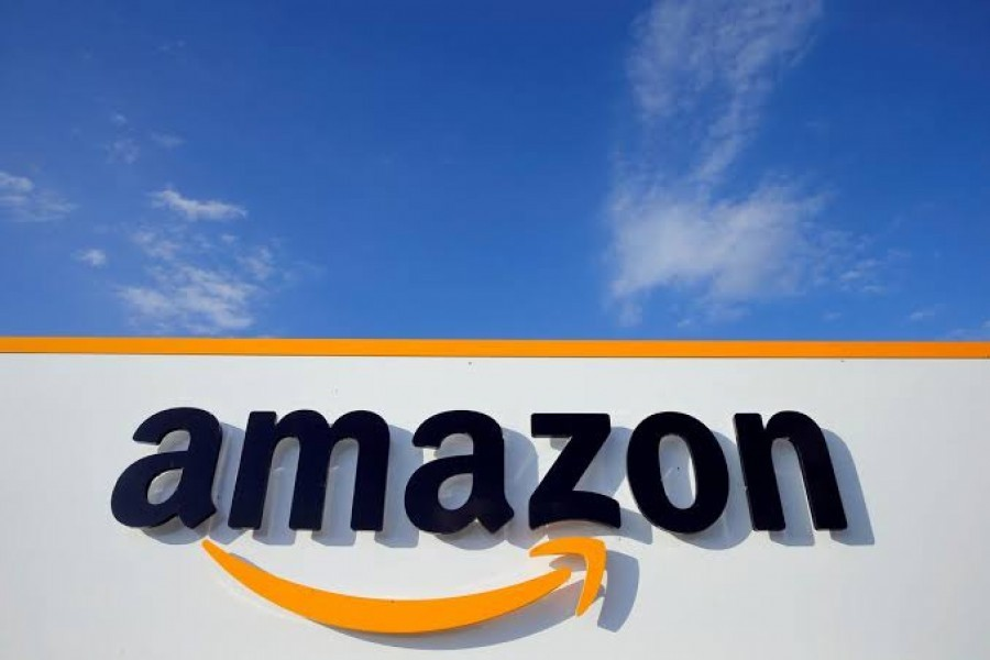 Amazon hiring 100,000 more workers to keep pace with online shopping surge