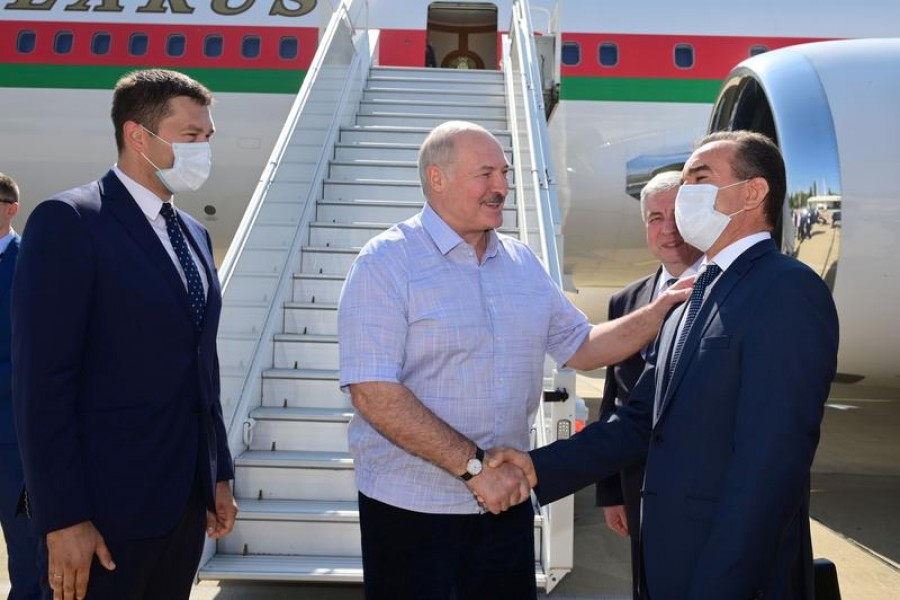 Belarusian President Alexander Lukashenko greets officials during a welcoming ceremony upon his arrival at an airport in Sochi, Russia on September 14, 2020 — Andrei Stasevich/BelTA/Handout via REUTERS