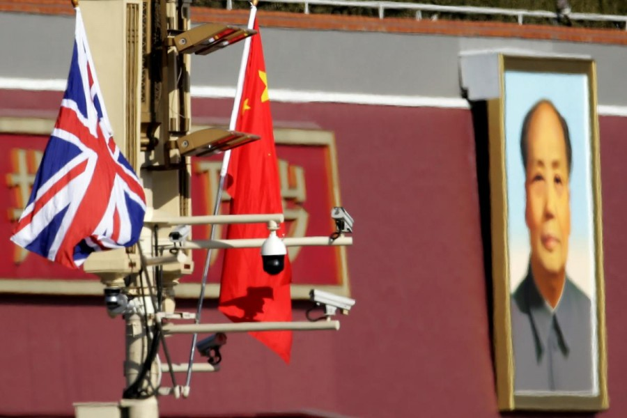 A Union flag and a Chinese flag are placed at a pole with security cameras in front of a portrait of late Chinese Chairman Mao Zedong at the Tiananmen gate during a visit by the then British Prime Minister Theresa May to China, in Beijing on January 31, 2018 — Reuters/Files
