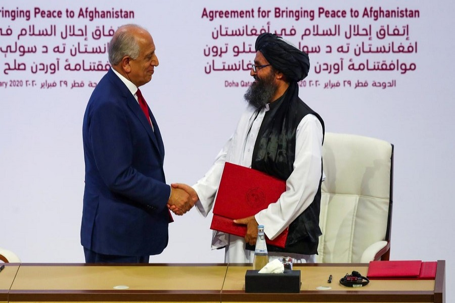 Mullah Abdul Ghani Baradar, the leader of the Taliban delegation, and Zalmay Khalilzad, US envoy for peace in Afghanistan, shake hands after signing an agreement at a ceremony between members of Afghanistan's Taliban and the US in Doha, Qatar, February 29, 2020 — Reuters/Files