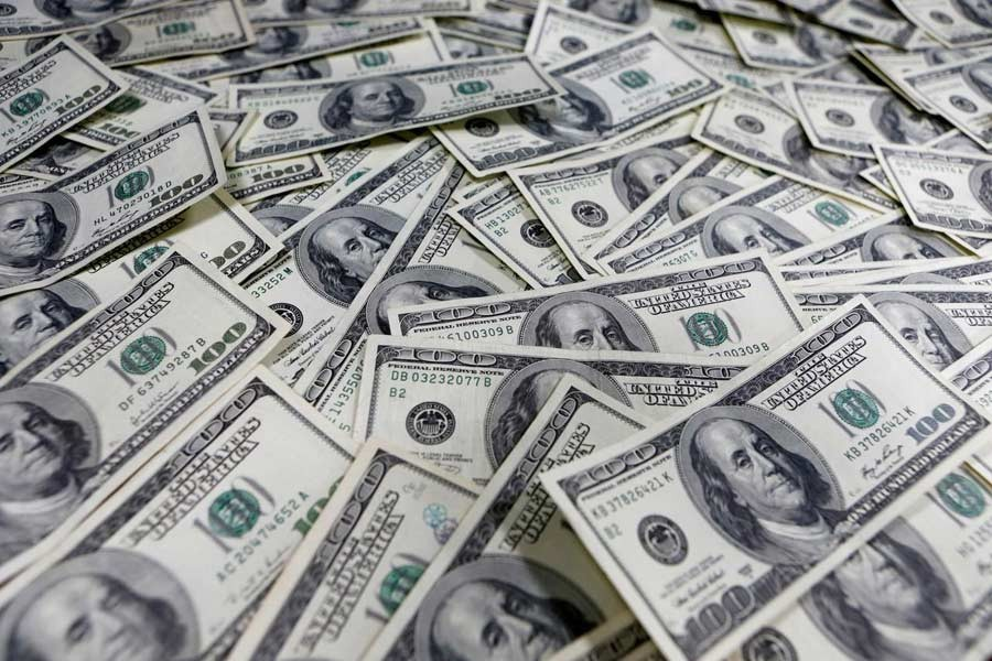Dollar dips as markets increase bets on more Fed easing