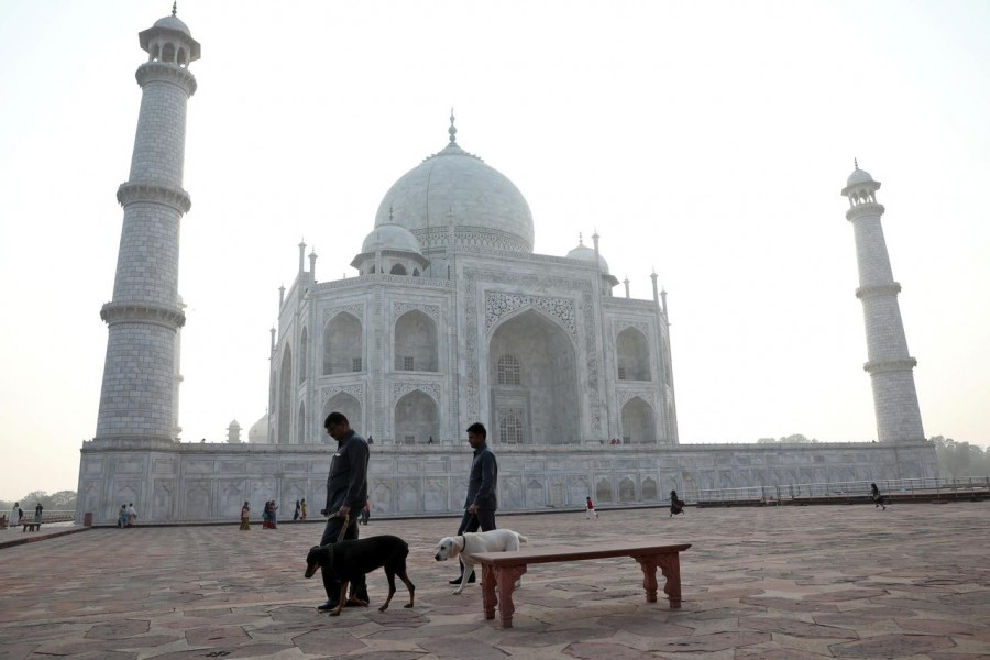 Police officers use sniffer dogs to scan the premises of the historic Taj Mahal, in Agra, India on February 24, 2020 — Reuters/Files