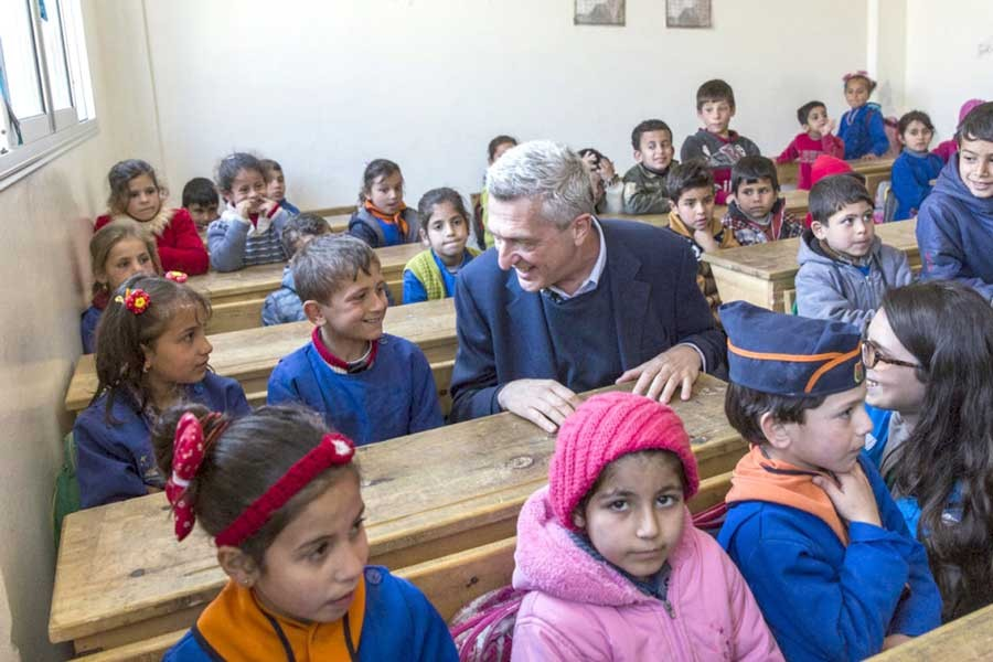 UNHCR chief Filippo Grandi chats with pupils at the Al-Shuhada School in Souran, Syria	–UNHCR Photo