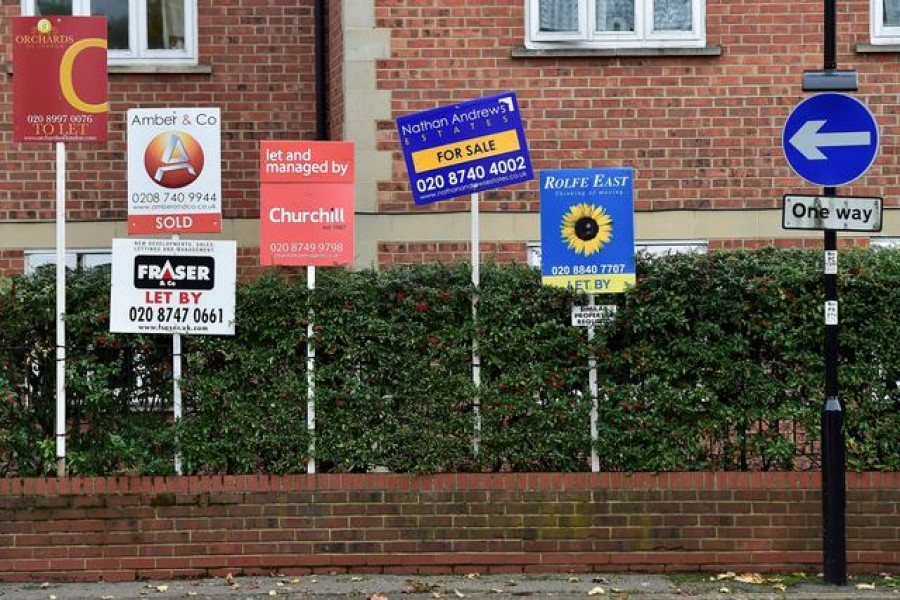 Property sale and rental signs are seen next to a street sign in London — Reuters/Files
